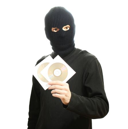 Bandit in black mask with CD disks isolated on white Stock Photo - 13082346