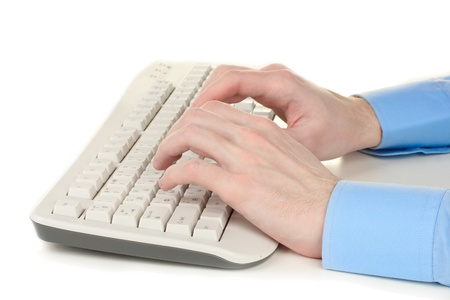 male hands typing on the keyboard isolated on white Stock Photo - 13083968