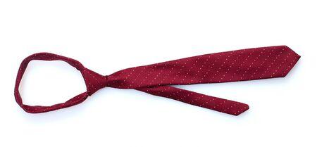 Elegant red tie isolated on white photo