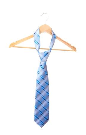 Elegant blue tie on wooden hanger isolated on white photo