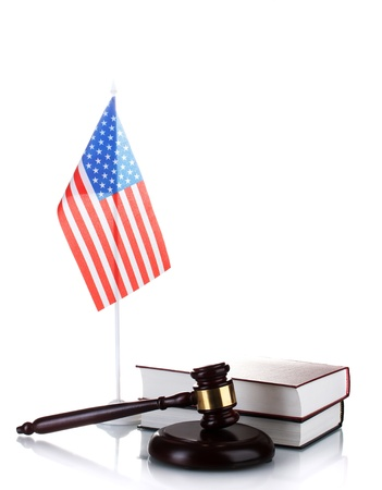 judge gavel, books and american flag isolated on white photo