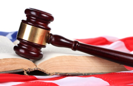 judge gavel and book on american flag on white background photo