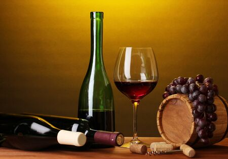 In wine cellar. Composition of wine bottles and runlet photo