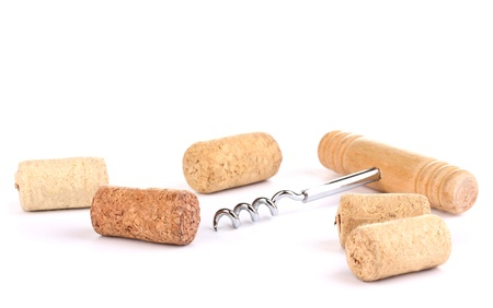 wines: Corkscrew with wine corks isolated on white Stock Photo