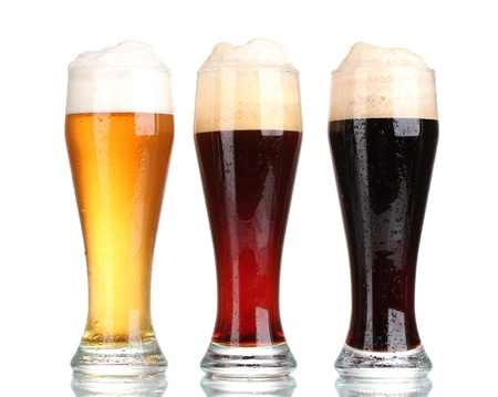 three glasses with different beers isolated on white photo