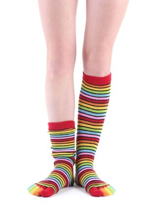 female legs in colorful striped socks isolated on white Stock Photo - 13083655