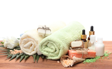 Spa setting on wooden table on white background photo