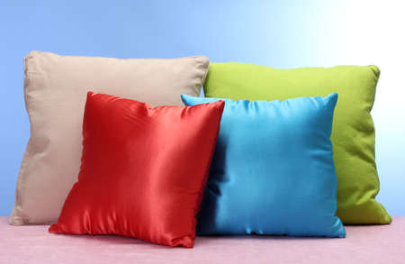 bright pillows on blue background photo