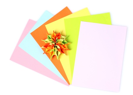 Colorfull origami and bright paper isolated on white photo