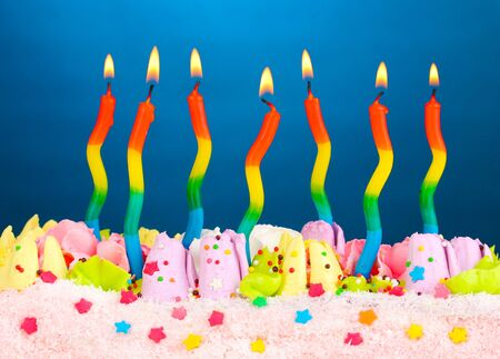 Birthday cake with candles on blue background Stock Photo - 13084627