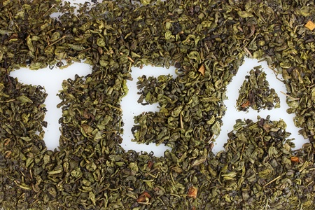 Word tea made of dry leaves closeup photo