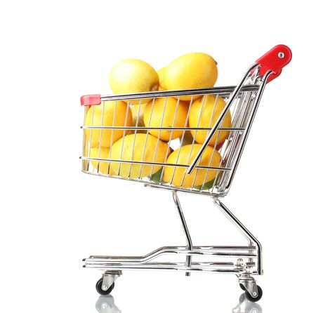 ripe lemons in shopping cart isolated on white photo