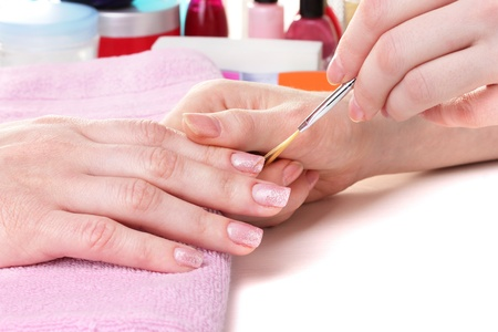 rasp: Manicure process in beautiful salon