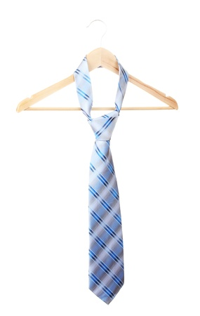 Elegant blue tie on wooden hanger isolated on white photo