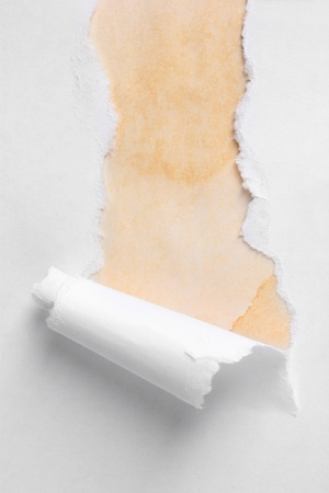 torn: Torn paper  with brown background