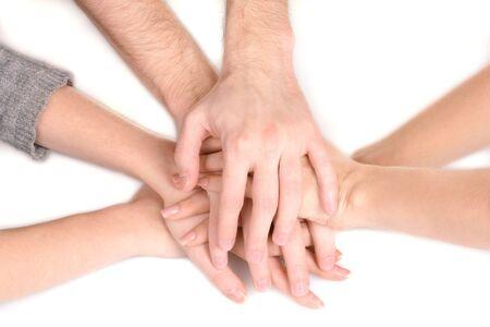 manos unidas: grupo de las manos de los j�venes aislados en blanco Foto de archivo