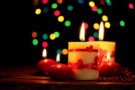 Beautiful candles on wooden table on bright background Stock Photo - 13178504