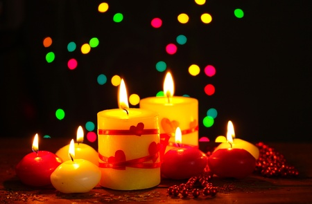 Beautiful candles on wooden table on bright background Stock Photo - 13178830