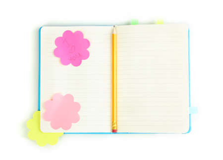 Open note book with stickies and pencil isolated on white photo