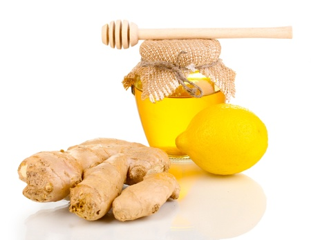 Ginger with lemon and honey isolated on white photo