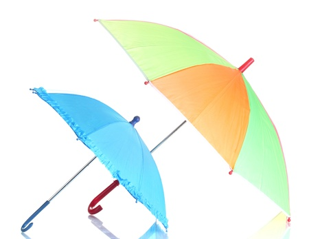 two colorful umbrellas isolated on white photo