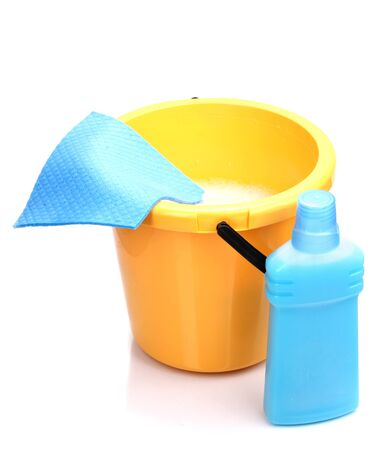 Bucket with detergent and cloth for cleaning isolated on white photo