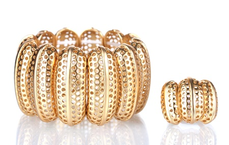 Beautiful golden bracelet and ring isolated on white Stock Photo - 13178857