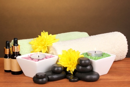 Spa setting on wooden table on brown background photo