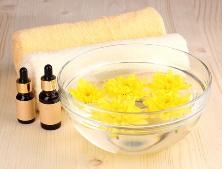 Bowl with yellow flowers, spa setting on wooden background Stock Photo - 13179059