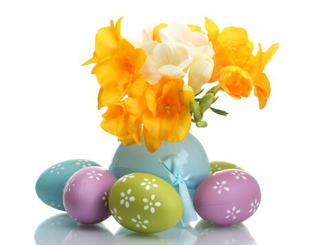 Beautiful yellow freesias in vase and Easter eggs isolated on white Stock Photo - 13178131
