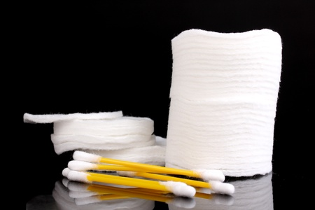 Cotton swabs and sticks isolated on black photo