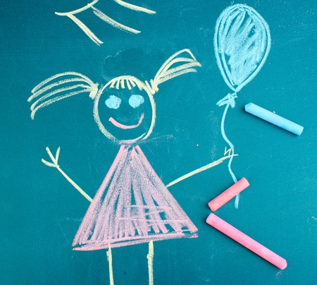 Little girl, childs drawing with chalk photo