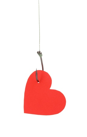 nylon string: Heart on fish hook isolated on white Stock Photo