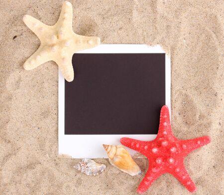 Photo with seashells and starfish on sand photo
