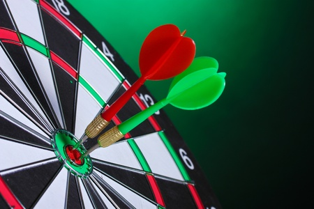 dart board with darts on green background Stock Photo - 13223856