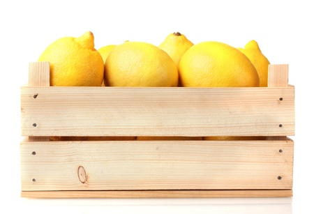 wooden box: ripe lemon in wooden box isolated on white Stock Photo
