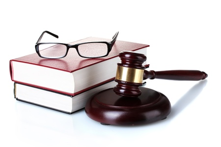 wooden gavel, glasses and books isolated on white photo
