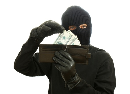 Bandit in black mask with stolen wallet isolated on white Stock Photo - 13268239