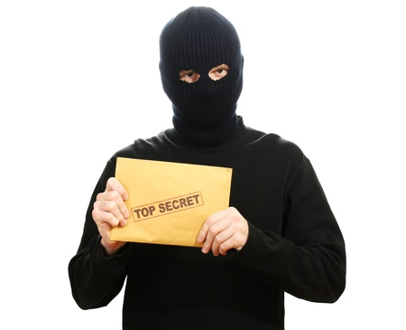 Bandit in black mask with top secret envelope isolated on white Stock Photo - 13264924