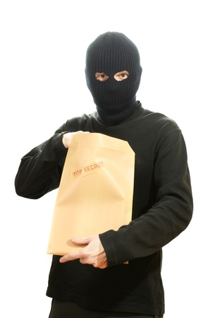 Bandit in black mask with top secret envelope isolated on white Stock Photo - 13268257