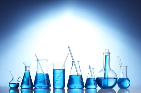 reagents: Test-tubes with blue liquid on blue background Stock Photo