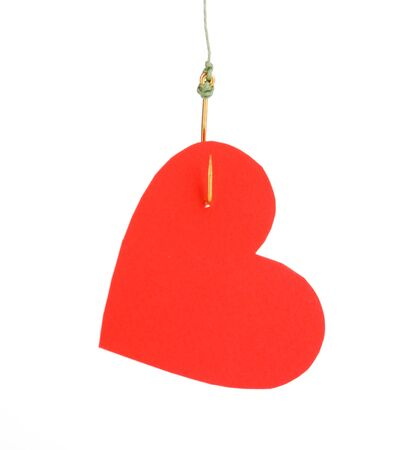 Heart on fish hook isolated on white Stock Photo - 13264910