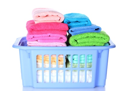 Plastic basket with bright towels isolated on white Stock Photo - 13265665