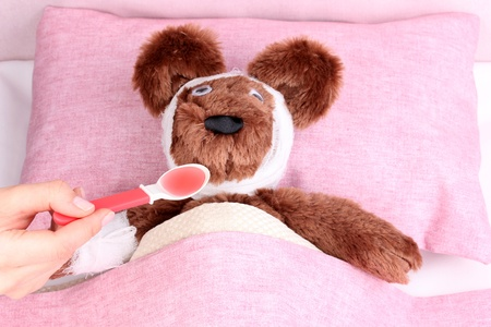 Sick bear in bed Stock Photo - 13265377