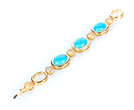 Beautiful golden bracelet with precious stones isolated on white photo