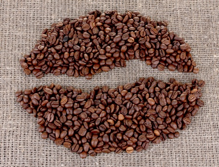 coffee beans on a sack background Stock Photo - 13264959