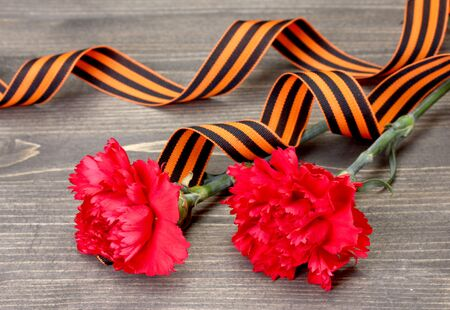 carnations and St. George's ribbon on grey wooden background Stock Photo - 13265411