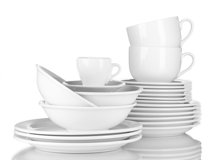 empty bowls, plates and cups on gray background photo
