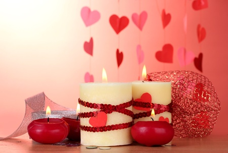 candles for Valentine's Day on wooden table on red background Stock Photo - 13374225