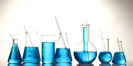 reagents: Test-tubes with blue liquid isolated on white Stock Photo